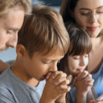 web3-family-pray-together-home-father-mother-child-shutterstock_1310080675