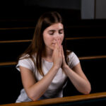 christian-girl-white-shirt-is-sitting-praying-with-humble-heart-church_7280-2043