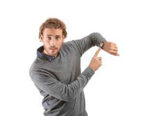 young-man-pointing-his-watch-white-background-young-man-pointing-his-watch-white-background-151329788
