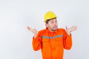 construction-worker-showing-helpless-gesture-uniform-helmet-looking-confused-front-view_176474-38698
