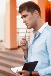 young-man-notebook-pen-thinking-work-pencil-87877204